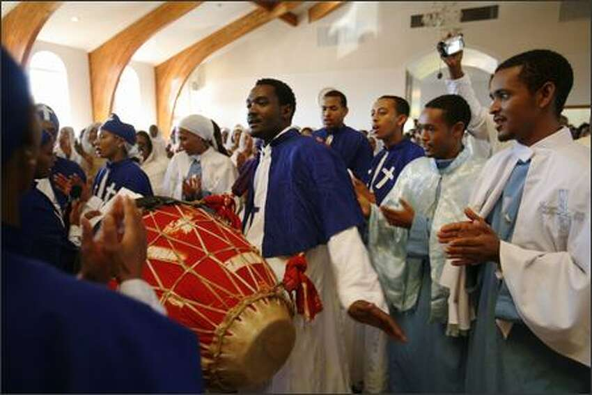 The choir sings a special song for the new millennium at St. Gebriel Church in Seattle on September 9, 2007, the Sunday before the millennium. The Ethiopian calendar is very much influenced by the Ethiopian Orthodox Church, which adheres to its ancient calendar rules. The Ethiopian calendar is always seven years and eight months behind the Gregorian and Eastern Orthodox Church calendars from September to December and eight years and four months behind, from January to August.