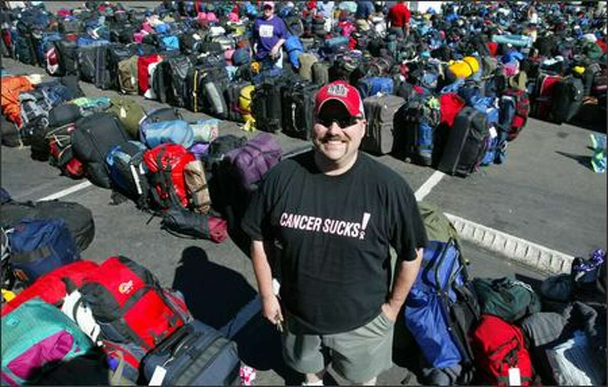 Kurt Meier waits for his wife in the luggage retrieval area in the parking lot of Memorial Stadium. Meier's wife was participating in the Seattle Breast Cancer 3-Day fund raiser, walking 60 miles over three days and camping out with the approximately 2,300 other participants.