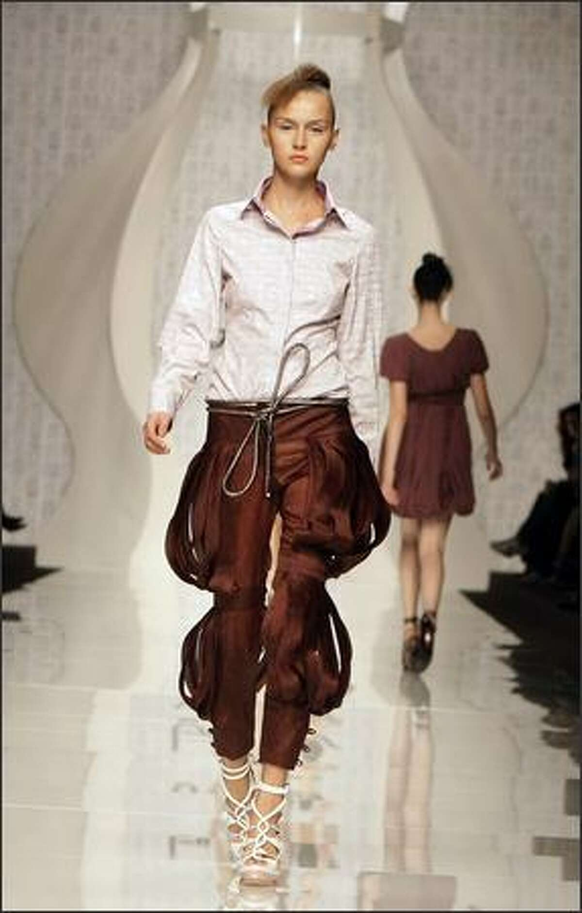 A model presents a creation by Byblos.