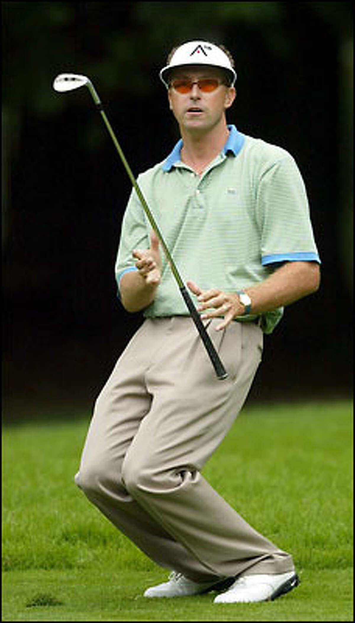 Robert Allenby from Austrralia reacts to a poor second shot on No. 11.