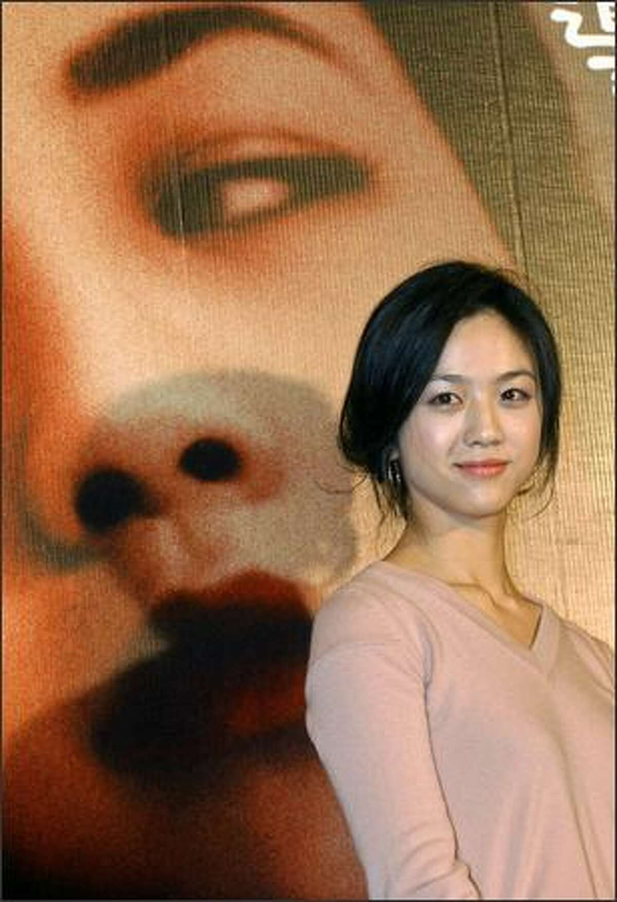 Chinese actress Tang Wei poses for photos during a press conference in Taipei, 24 September 2007, hours before the local premiere of Director Ang Lee's award-winning film