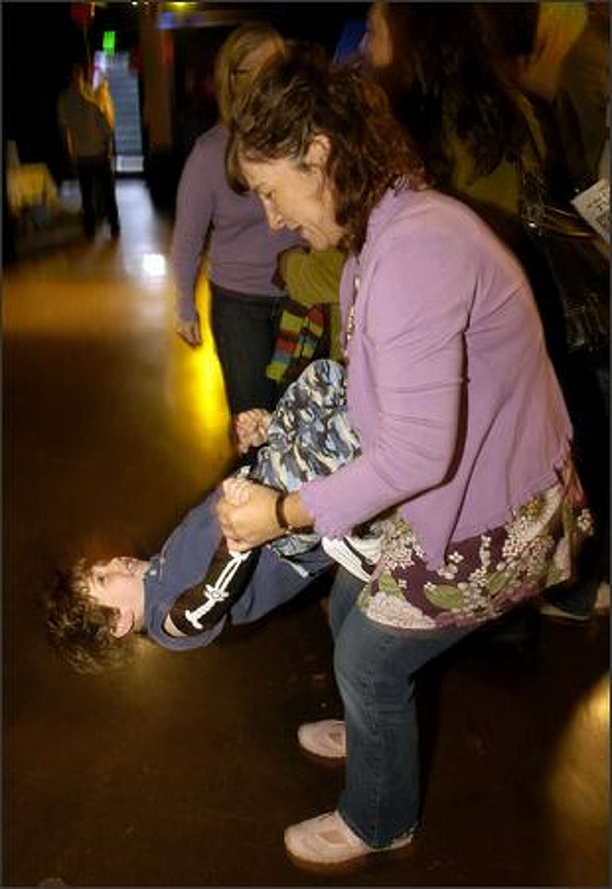 Harris Weiskopf, 4, turns upside down while dancing with mom Hope at Saturday's Baby Loves Disco party held at Club Heaven in Seattle.