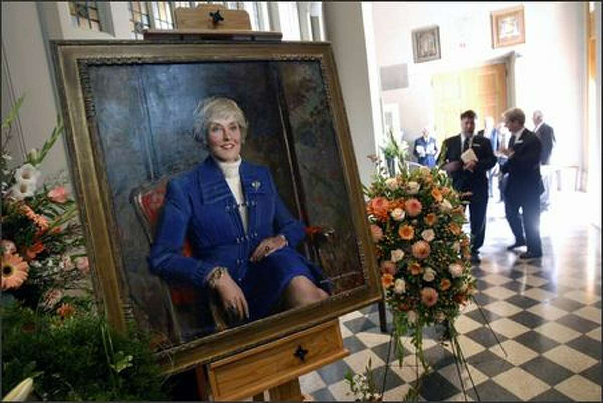 A painted portrait of former U.S. Rep. Jennifer Dunn greets guests at St. James Cathedral in Seattle.
