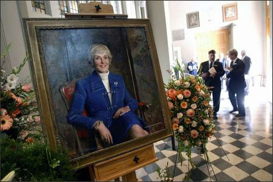 A painted portrait of former U.S. Rep. Jennifer Dunn greets guests at St. James Cathedral in Seattle. Photo: Andy Rogers, Seattle Post-Intelligencer