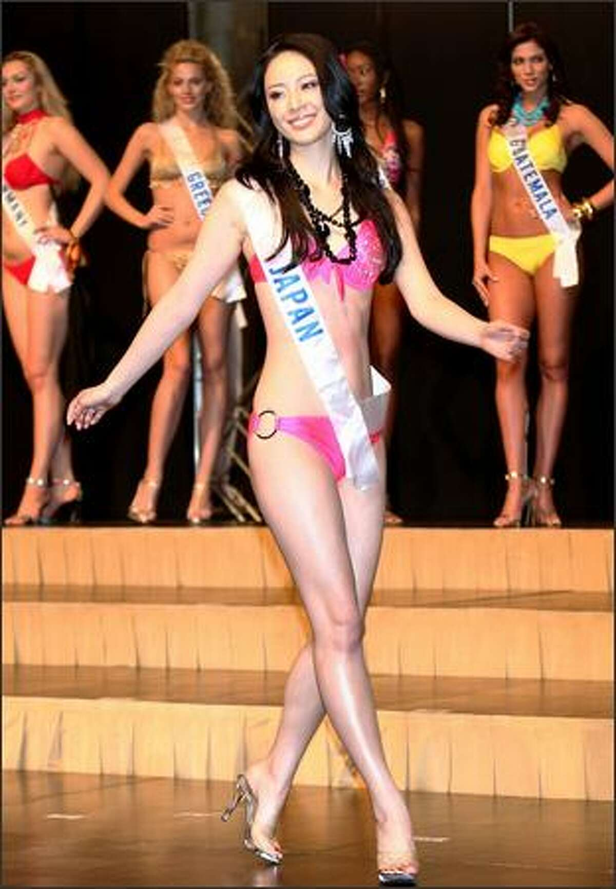 Miss Japan Hisako Shirata who has been selected as Miss Photogenic poses during a press preview of the