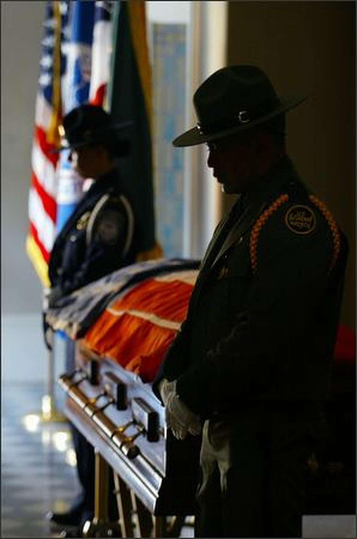 Two members of the U.S. Border Patrol stand watch by the coffin of former U.S. Rep. Jennifer Dunn as guests arrive at St. James Cathedral in Seattle.