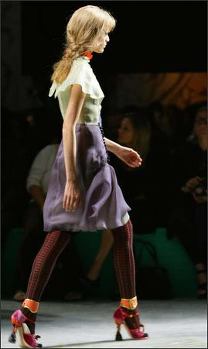 A model presents a creation by Italian designer Miuccia Prada during the spring/summer 2008 collections of the Milan ready-to-wear fashion shows.