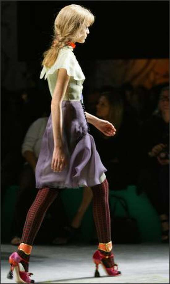 A model presents a creation by Italian designer Miuccia Prada during the spring/summer 2008 collections of the Milan ready-to-wear fashion shows. Photo: Getty Images