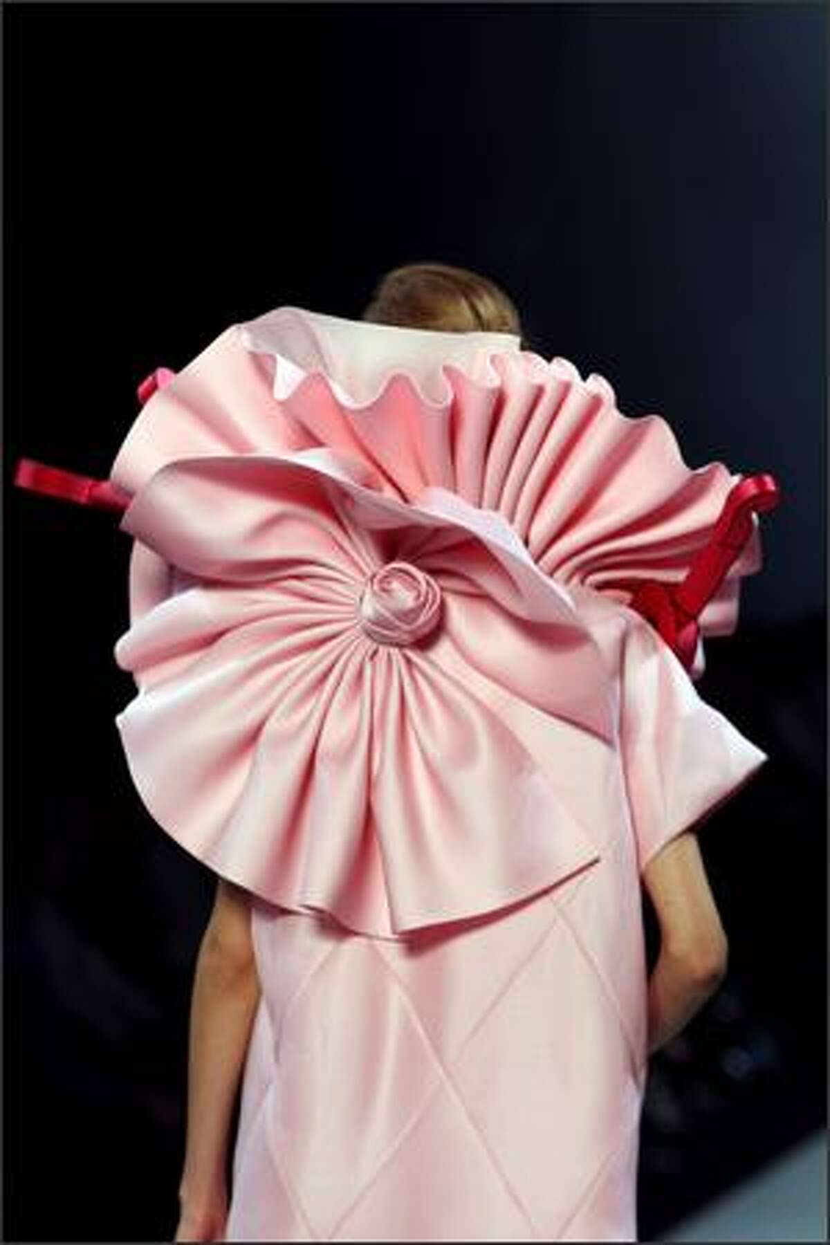 A model presents a creation by Dutch designers Viktor & Rolf during the Spring/Summer 2008 ready-to-wear collection show in Paris.