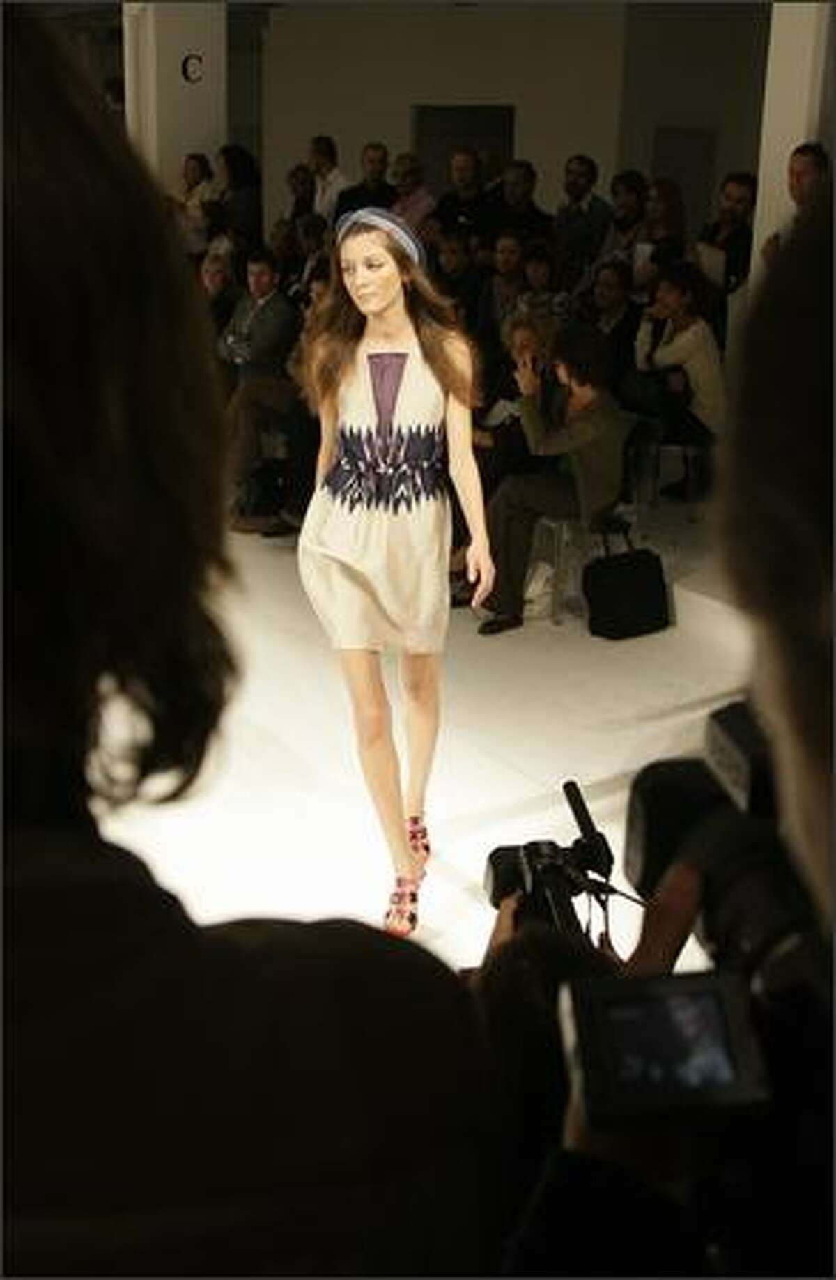 A model presents a creation by Turkish designer Rifat Ozbek for Pollini during the spring/summer 2008 collections of the Milan ready-to-wear fashion shows.