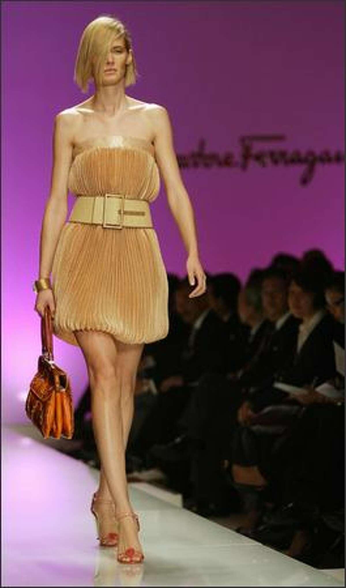 A model presents a creation by Graeme Black for Salvatore Ferragamo.