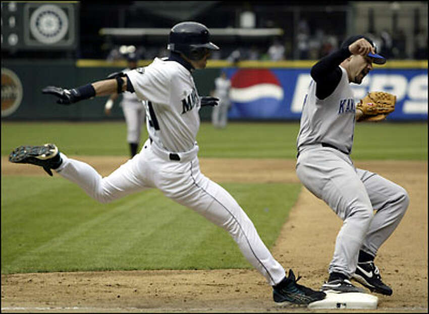 Ichiro Suzuki stretches in an attempt to reach first base ahead of Royals pitcher Jeff Suppan, but was called out on the play in the second inning. The Mariners won 9-4.