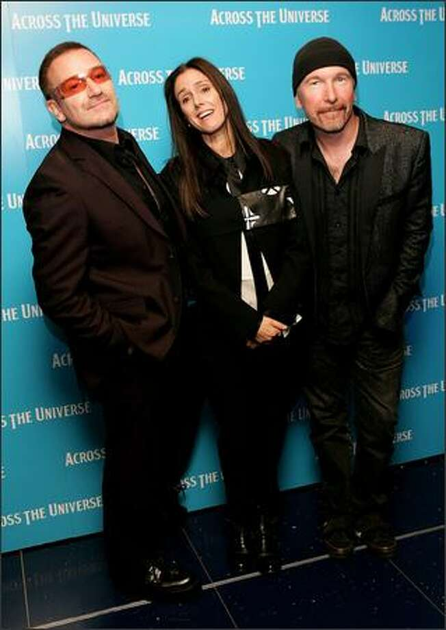 "Left to right, Bono, director Julie Taymor and The Edge arrive at the gala premiere of ""Across The Universe"" at the Apollo West End on September 26, 2007 in London, England. Photo: Getty Images"