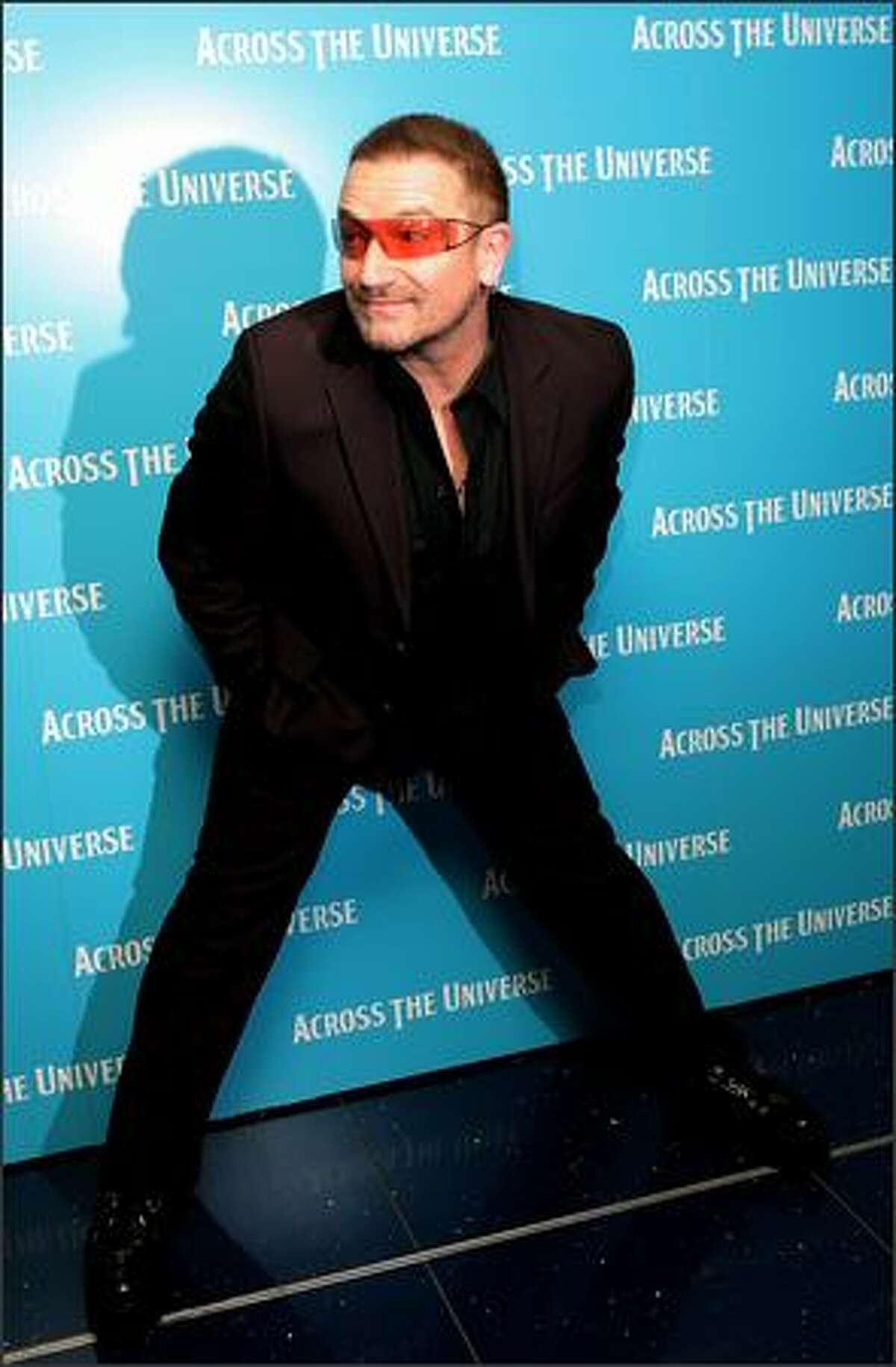 U2 frontman Bono arrives at the gala premiere of