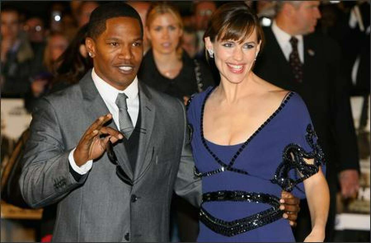 Jamie Foxx and Jennifer Garner attend The Kingdom film premiere held at the Odeon West End on October 4, 2007 in London.