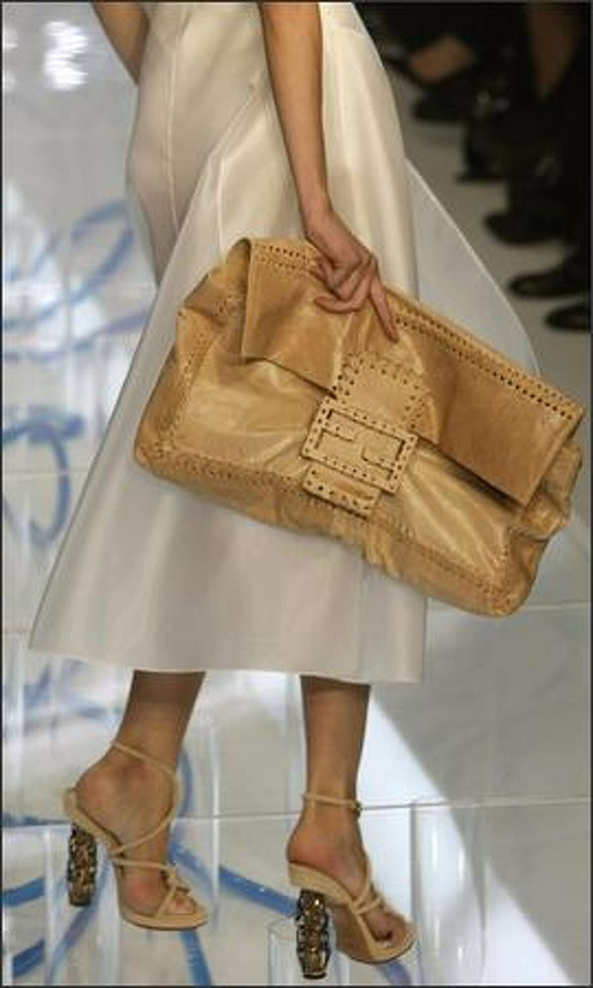 A model presents a creation by Fendi during the Spring/Summer 2008 collections of the Milan ready-to-wear fashion shows.