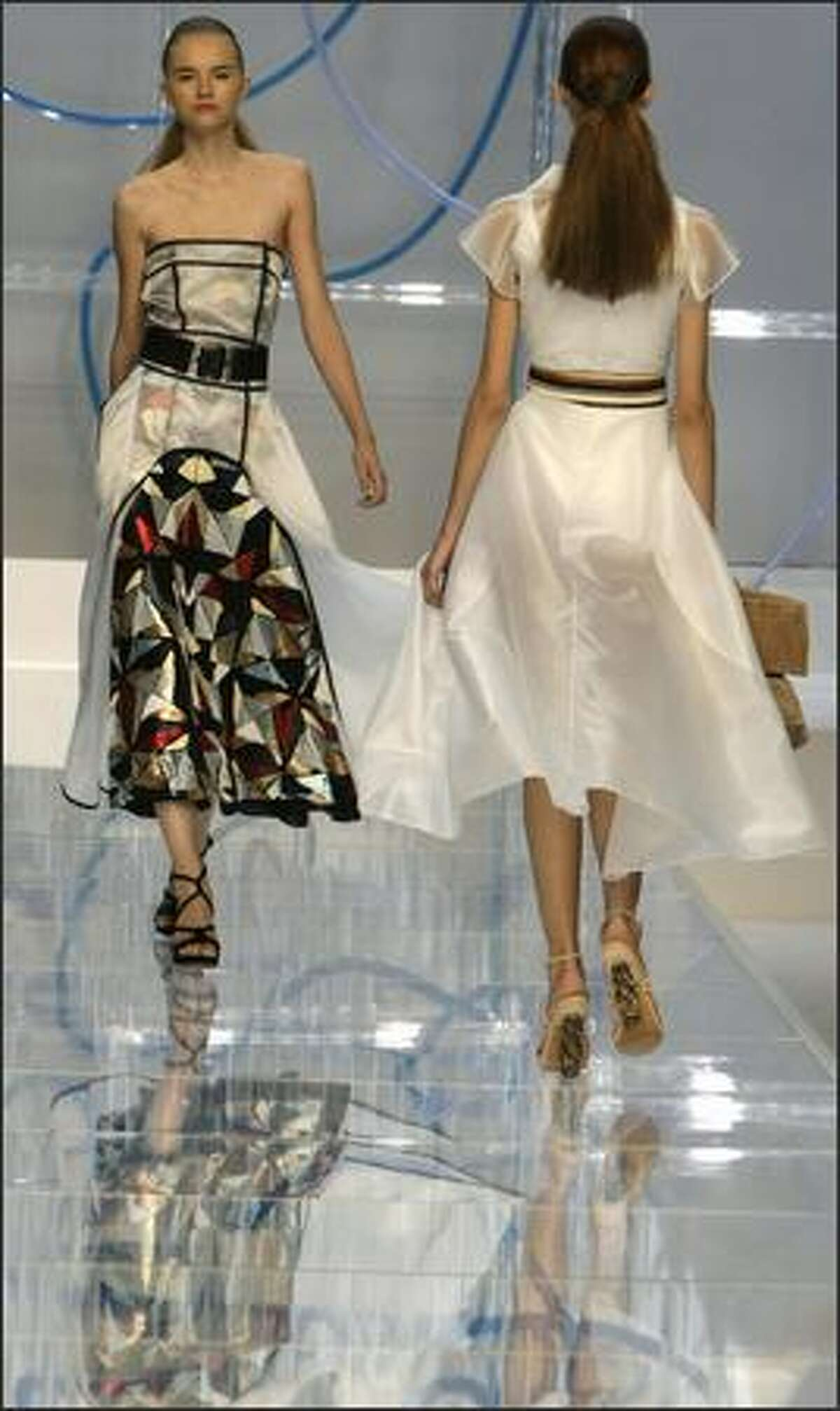 Models present creations by Fendi during the Spring/Summer 2008 collections of the Milan ready-to-wear fashion shows.