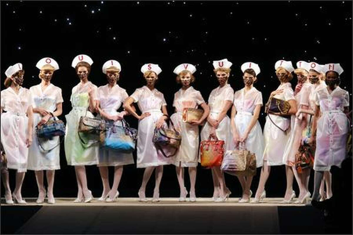 Models present creation by US designer Marc Jacobs for Louis Vuitton during Spring/Summer 2008 ready-to-wear collection show in Paris.