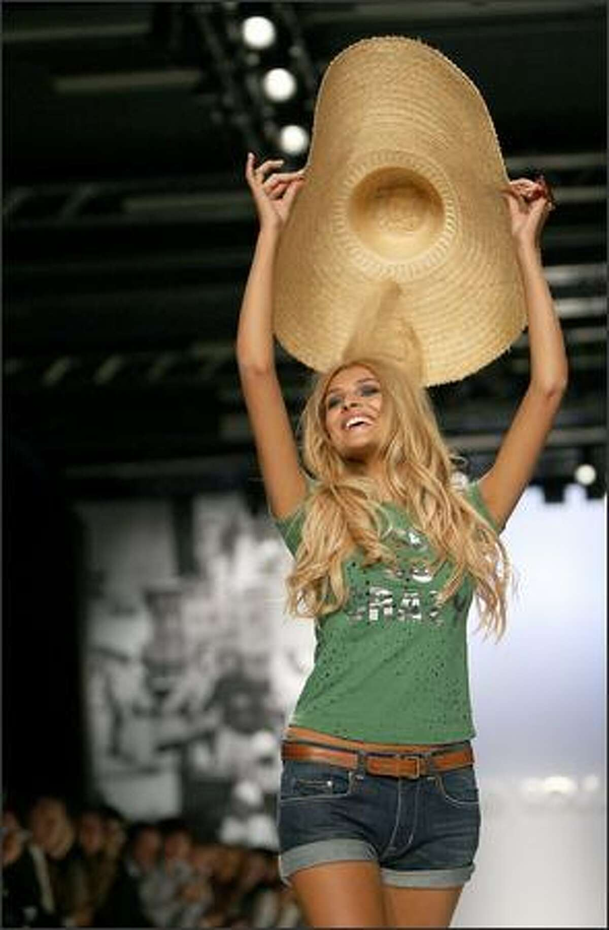 Miss Italy 2004, Christina Chiabotto, presents a creation by Ab Soul.
