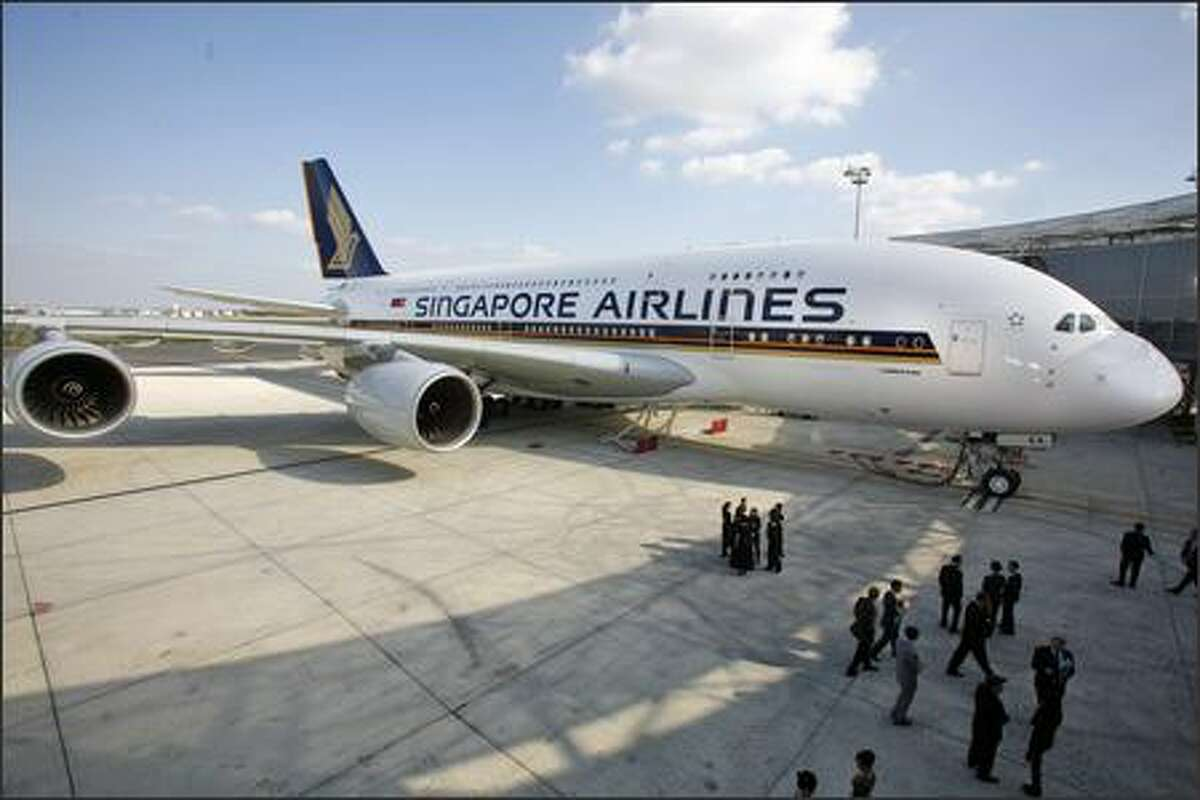 The Airbus A380 is seen in Toulouse, France ready to join the Singapore Airlines fleet. European aircraft maker Airbus delivered its first A380, the world's biggest passenger plane, to the Asian carrier during a ceremony marking the occasion on Monday, Oct. 15, 2007.
