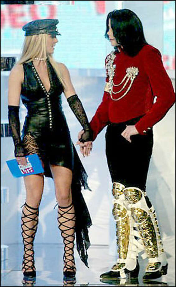 Michael Jackson, right, accepts a special birthday gift from Britney Spears to celebrate his 44th birthday. Photo: Associated Press