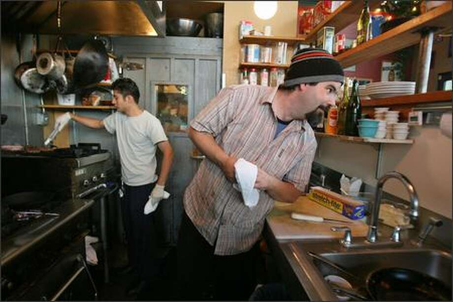 Chef Jed Lutge gets credit for slowly adding upscale dishes to the laid-back menu so regulars wouldn't get ruffled. Photo: Mike Urban, Seattle Post-Intelligencer