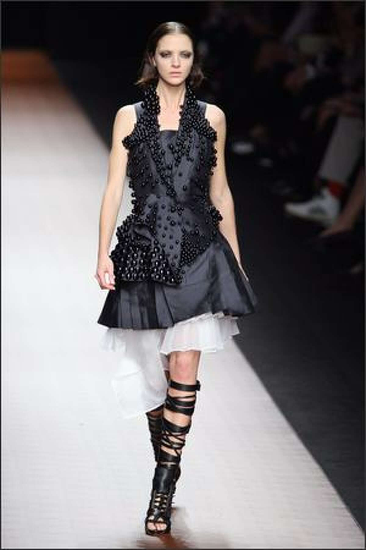 Italian model Maria Carla Boscono presents a creation by Ricardo Tisci for Givenchy.