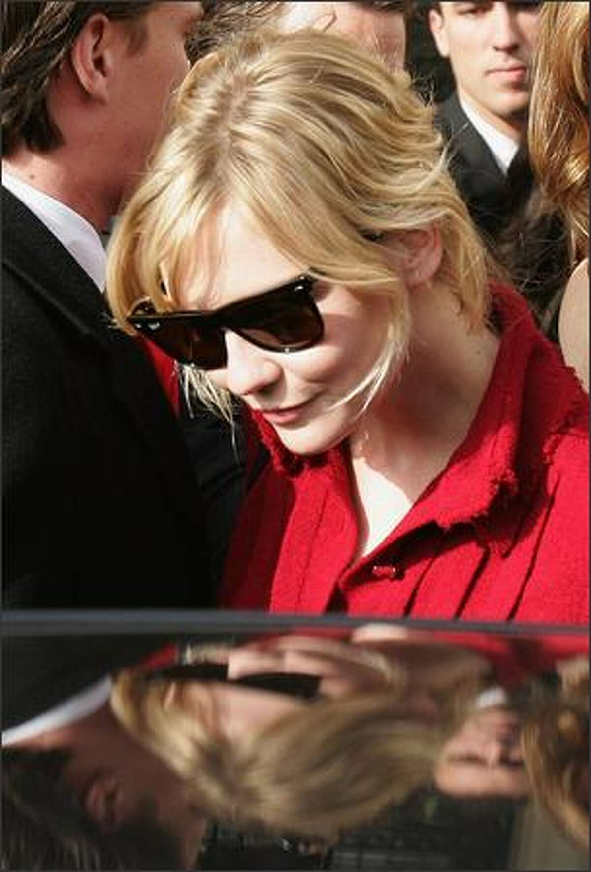 Actress Kirsten Dunst leaves after attending the Chanel Fashion show during the Paris Fashion Week Sp/Sum October 5, 2007 in Paris, France.
