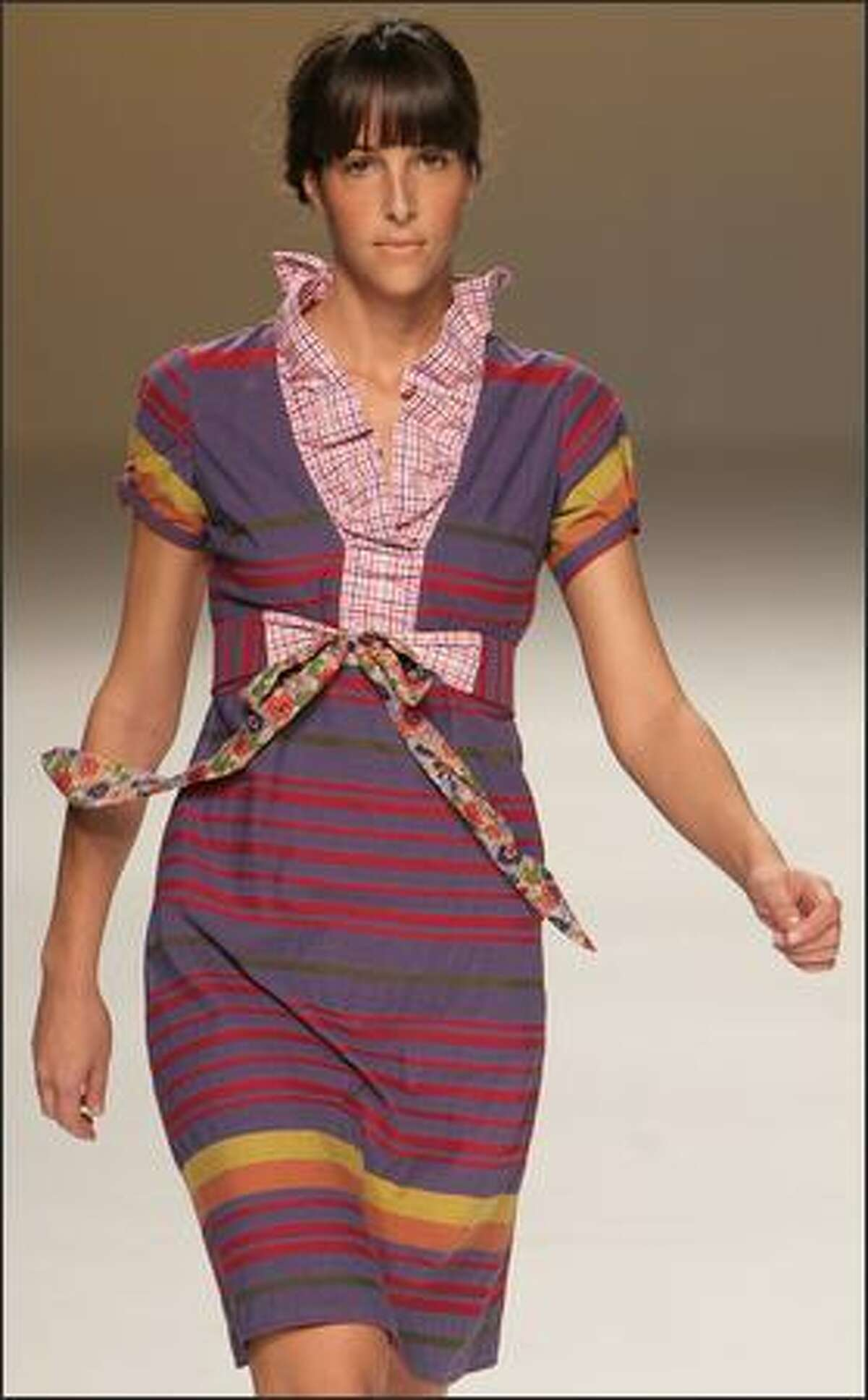 A model shows an outfit by Portuguese designer Anabel Baldaque.