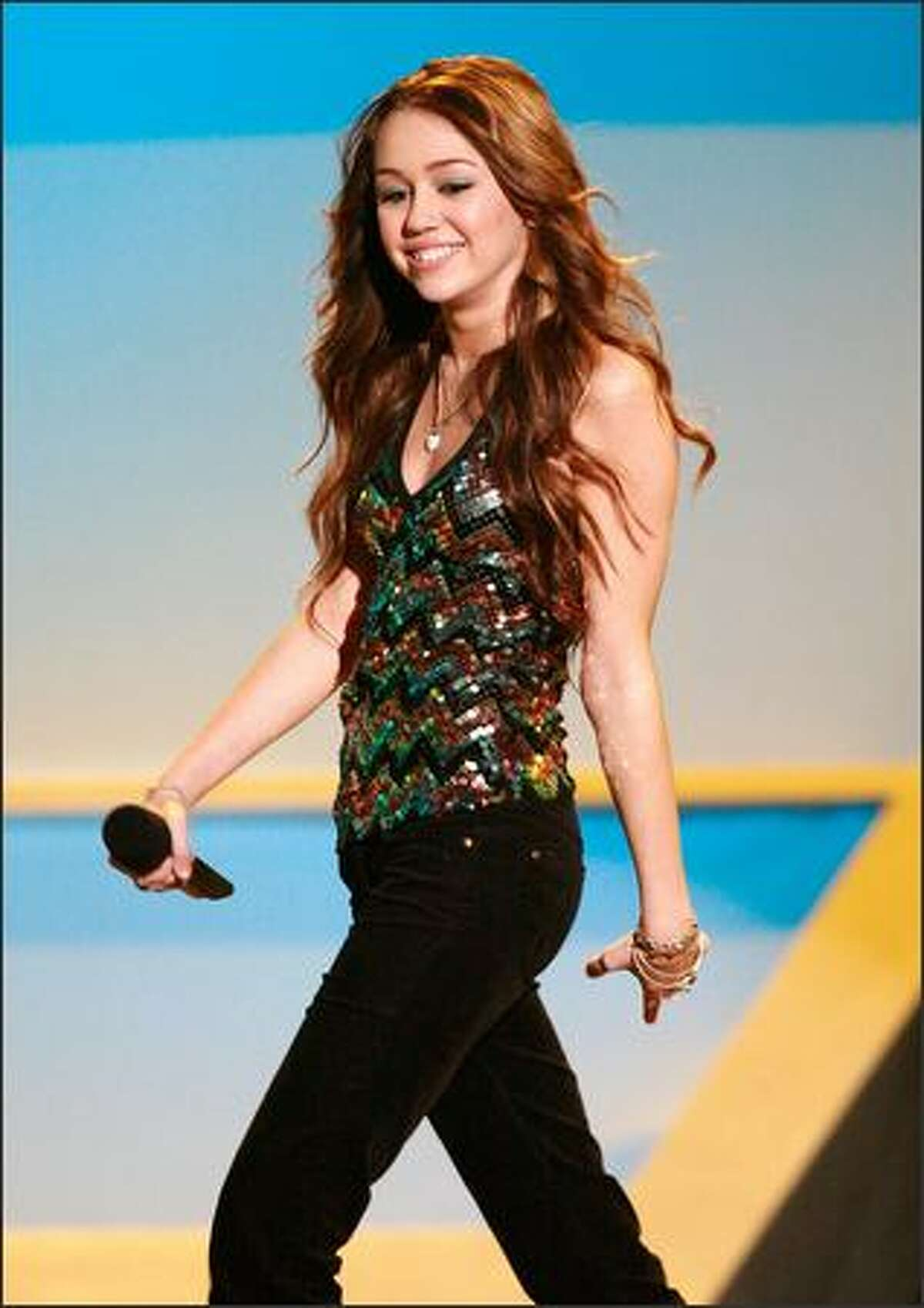 Actress Miley Cyrus walks onstage during the VH1 Big in '06 Awards held at Sony Studios in Culver City, Calif. on Dec. 2, 2006.