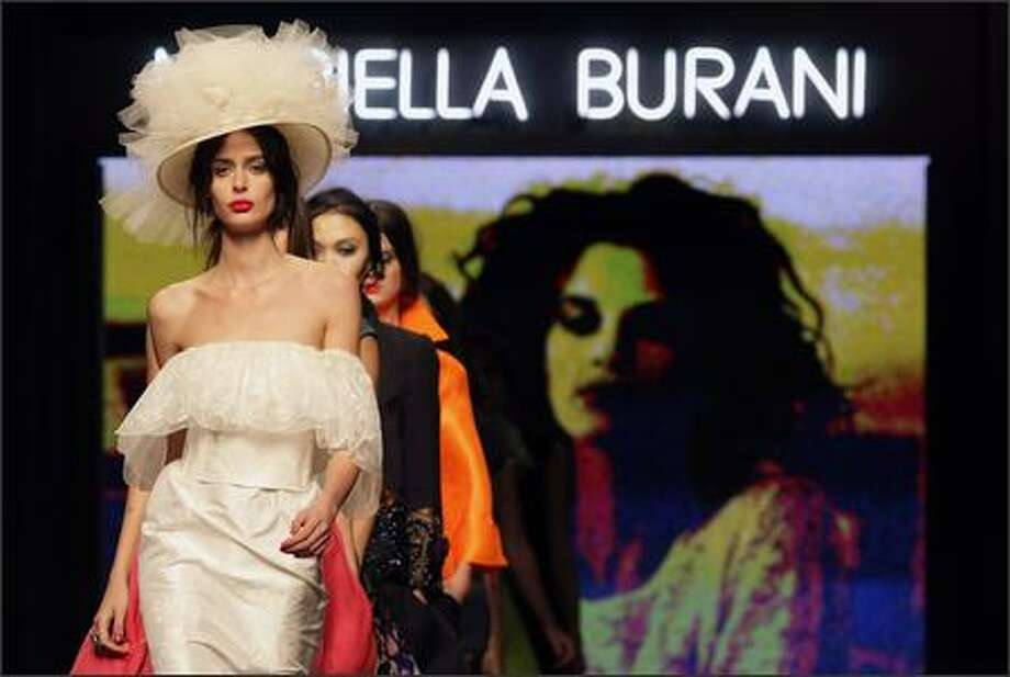 A model presents a creation by Italian designer Mariella Burani during the spring/summer 2008 collections of the Milan ready-to-wear fashion shows. Photo: Getty Images