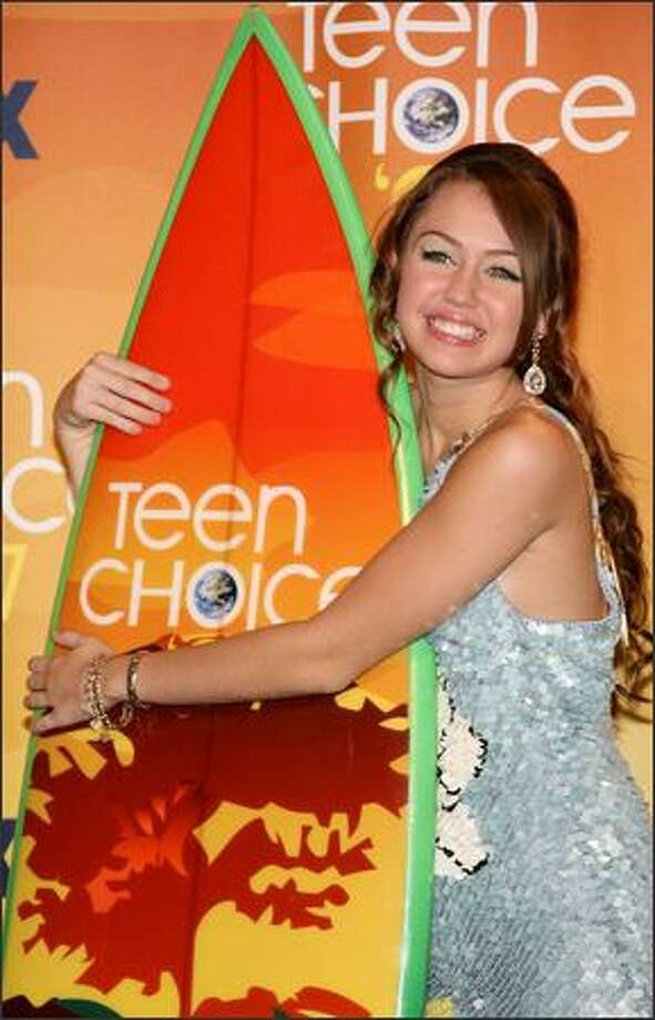 Miley Cyrus poses in the press room during the 2007 Teen Choice Awards at the Gibson Amphitheatre in Universal City, Calif. on Aug. 26, 2007. Photo: Getty Images