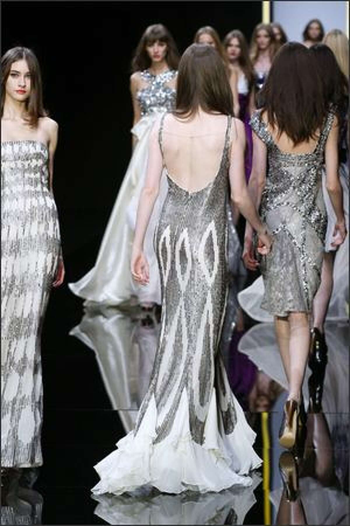 Models present creations by Lebanese designer Elie Saab during Spring/Summer 2008 ready-to-wear collection show in Paris, 06 October 2007.