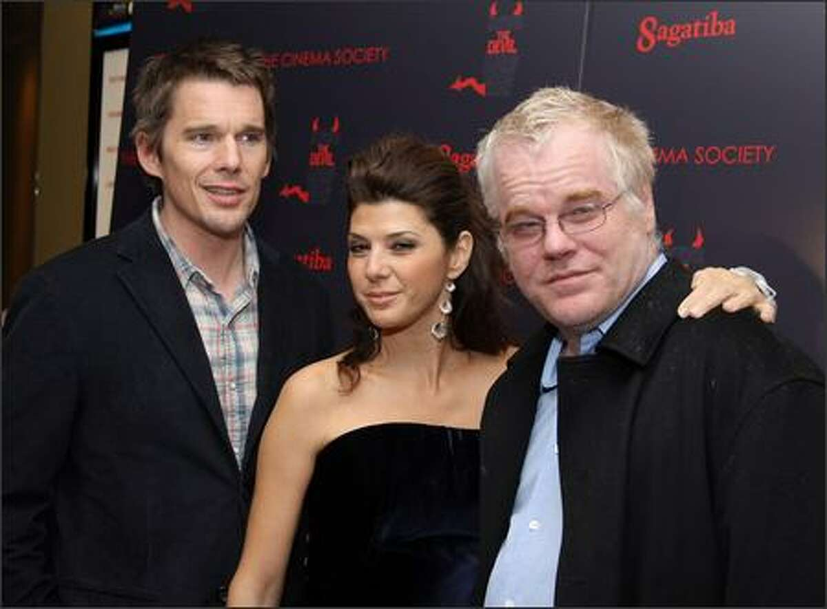 (L-R) Actors Ethan Hawke, Marisa Tomei and Philip Seymour Hoffman attend the New York premiere of