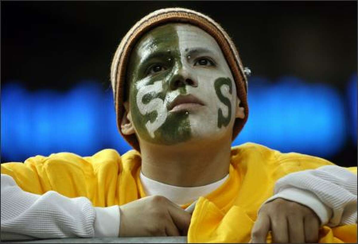 Sonics fan Ricky Garcia, from Los Angeles, in town to visit his aunt, wouldn't miss Sonics opening night and painted his face to support the team.