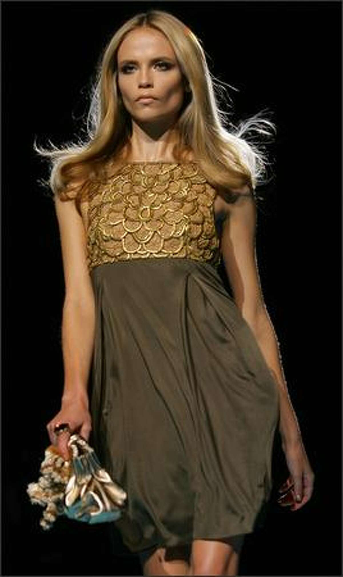 A model presents a creation by Italian designer Donatella Versace for Italian fashion house Gianni Versace during the Spring/Summer 2008 collections of the Milan ready-to-wear fashion shows.