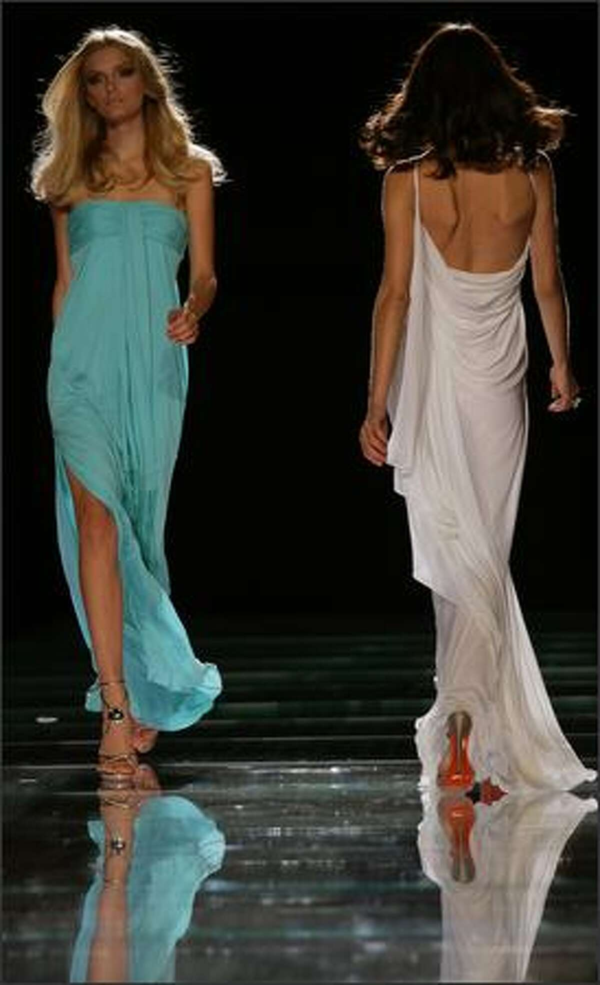 Models present creations by Italian designer Donatella Versace for Italian fashion house Gianni Versace during the Spring/Summer 2008 collections of the Milan ready-to-wear fashion shows.