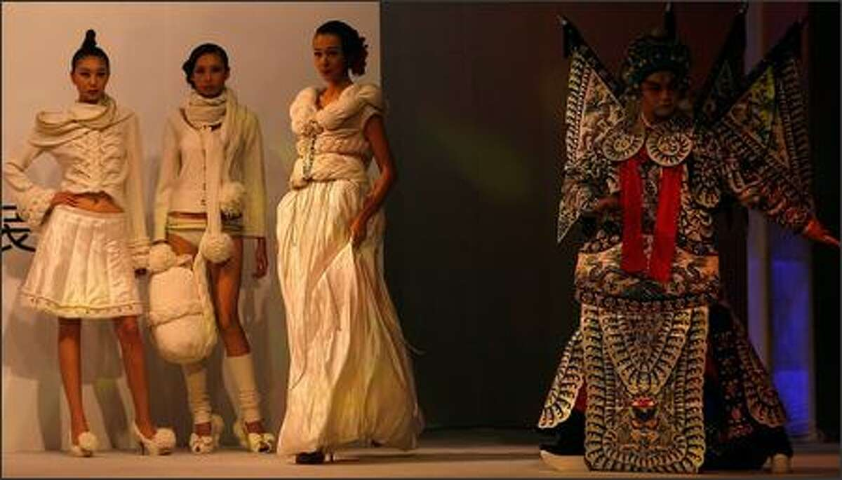 """Models and a Peking Opera performer walk the runway during the fashion show of Chinese brand """"1436"""" at the 2007 Shanghai Fashion Week on October 28, 2007 in Shanghai, China."""
