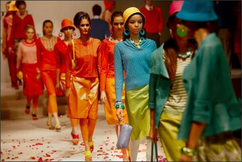 Models walk the runway during the fashion show of Chinese brand