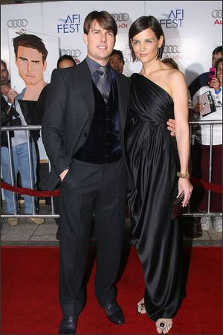 Cast member Tom Cruise and his wife Katie Holmes arrive for the AFI FEST 2007 opening night gala premiere of