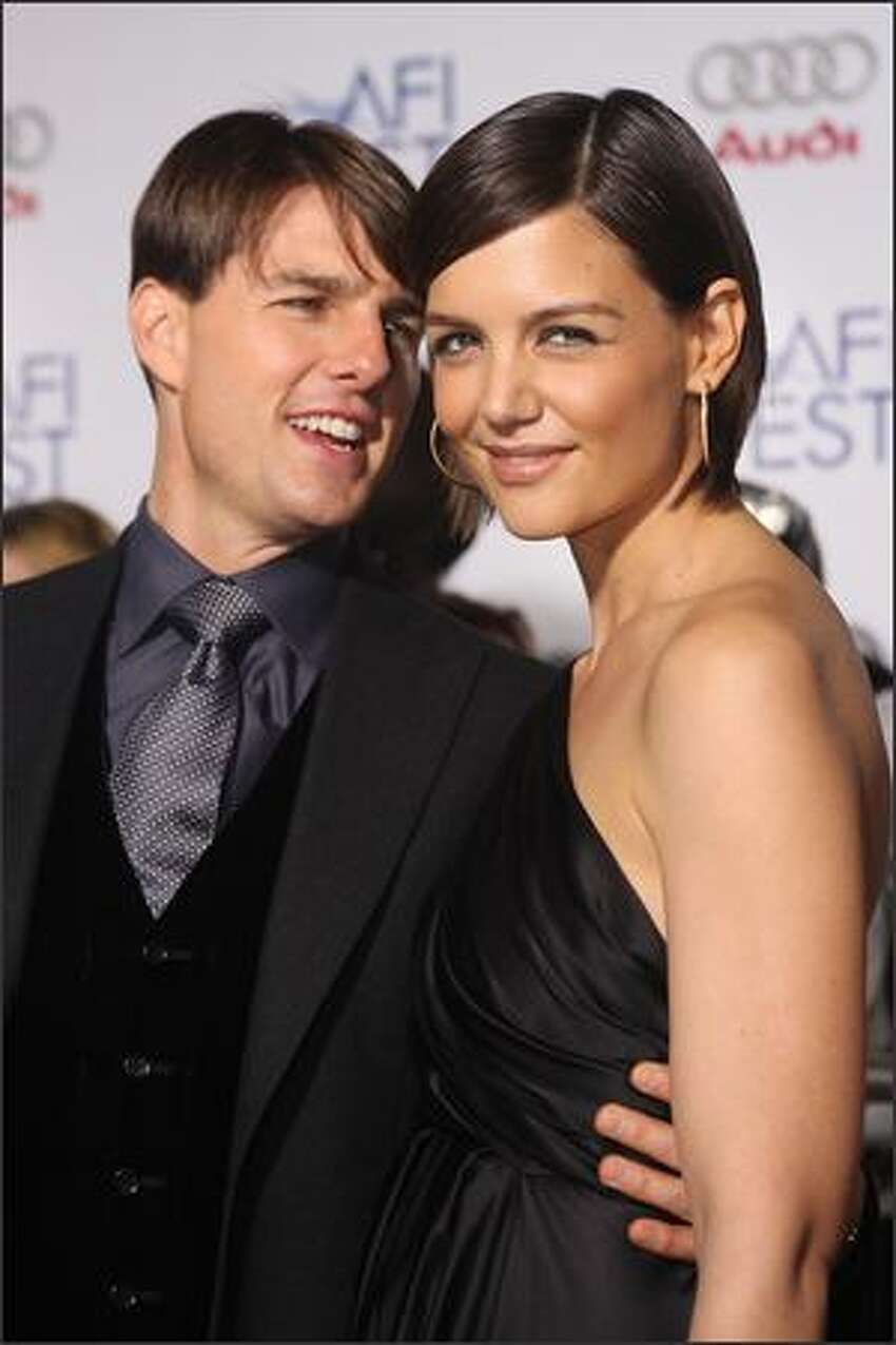 Tom Cruise and Katie Holmes arrive.