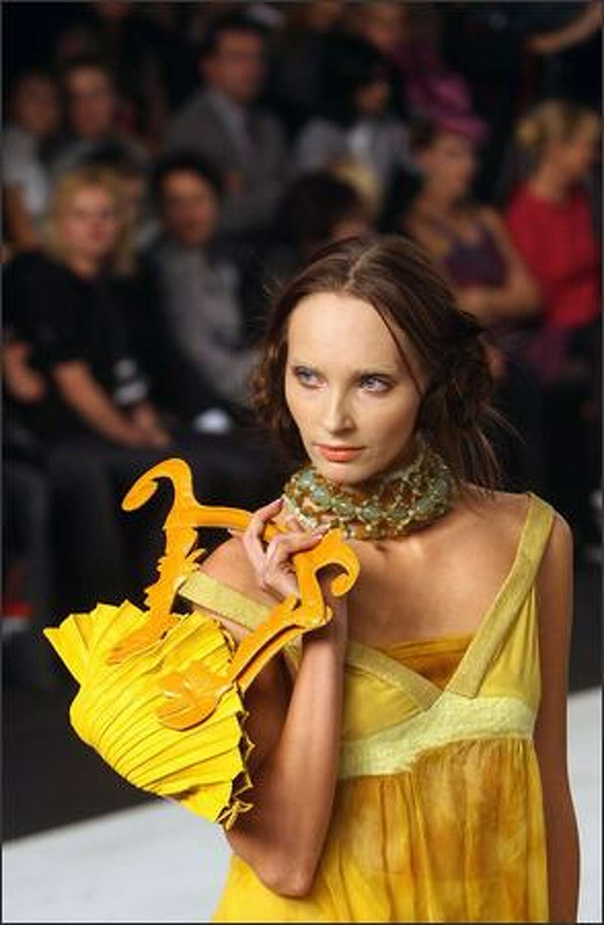 A model displays an outfit from the ready-to-wear collection by popular Ukrainian fashion designer Oksana Karavanska during the opening of Ukrainian Fashion Week 11 October 2007 in Kiev.
