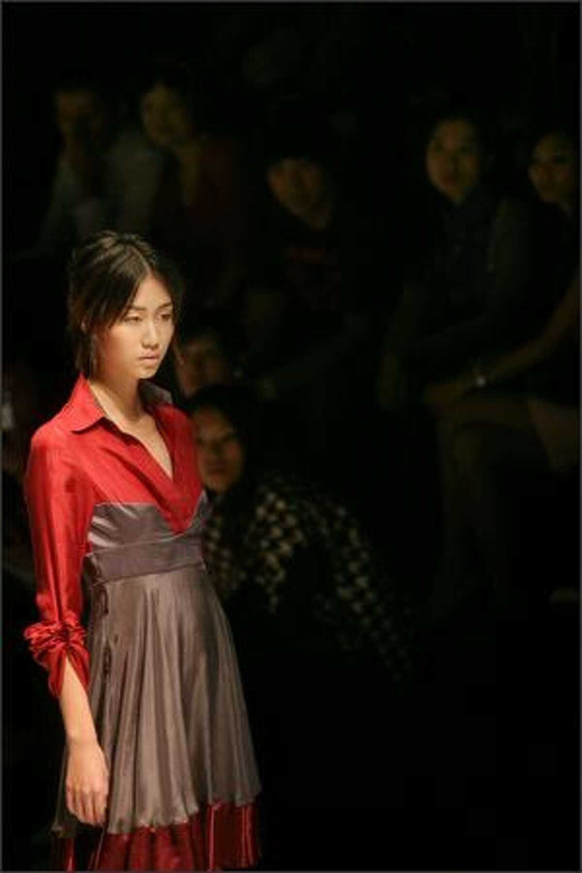 A model walks the runway during the fashion show of Turkish designer Bora Aksu at the 2007 Shanghai Fashion Week on October 30, 2007 in Shanghai, China.