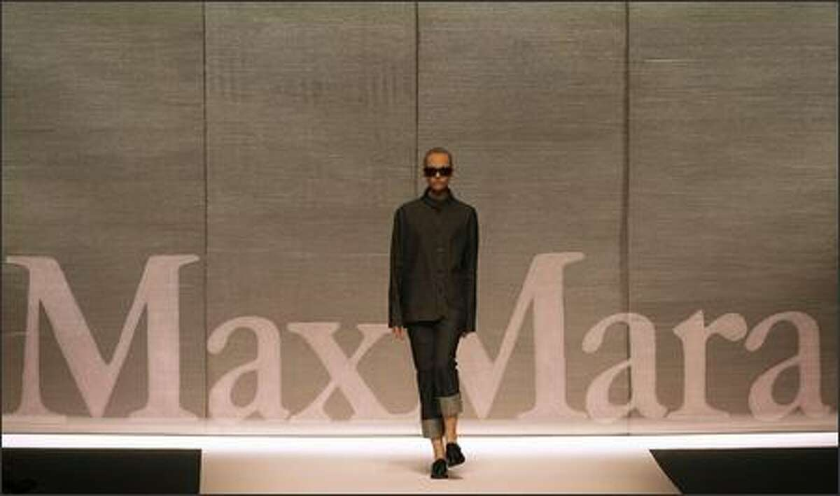 A model presents a creation by Italian fashion house Max Mara during the Spring/Summer 2008 collections of the Milan ready-to-wear fashion shows.