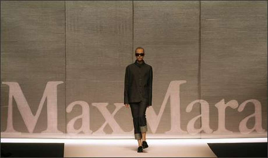 A model presents a creation by Italian fashion house Max Mara during the Spring/Summer 2008 collections of the Milan ready-to-wear fashion shows. Photo: Getty Images