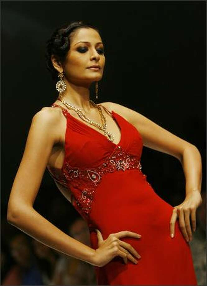 A model displays a creation by a Pakistani designer, during the Lakme Fashion Week at the National Centre for Performing Arts (NCPA) in Mumbai, 14 October 2007. The creative designes will be showcased in the upcoming Pakistan Fashion week. Fifty-four designers from across India and Pakistan will be displaying their collections during the five-day event in the western Indian city. Photo: Getty Images