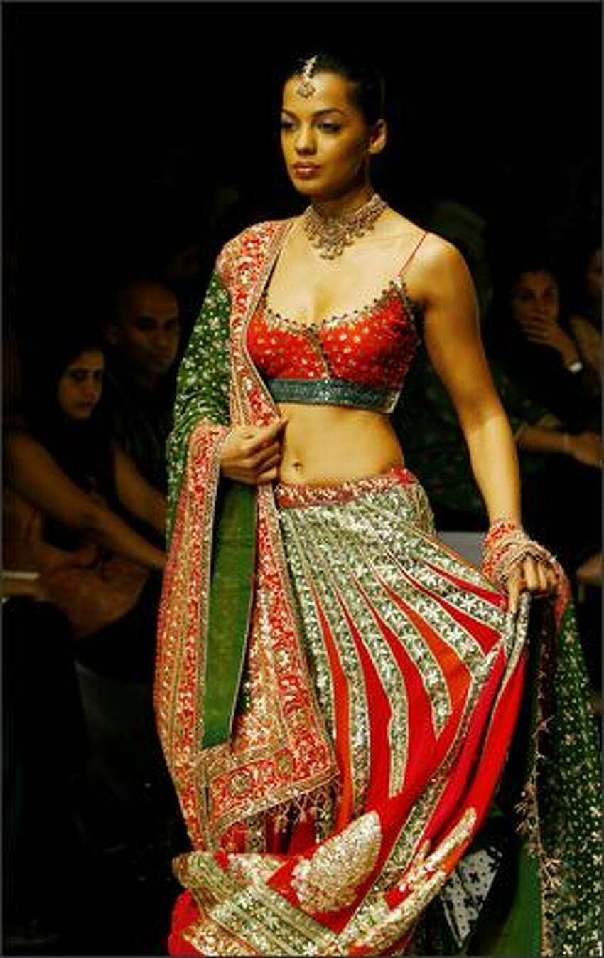 A Model displays a creation by Indian designers Shyamal and Bhumika during the Lakme Fashion Week at the National Centre for Performing Arts (NCPA) in Mumbai, 14 October 2007. Fifty-four designers from across India and Pakistan will be displaying their collections during the five-day event in the western Indian city.