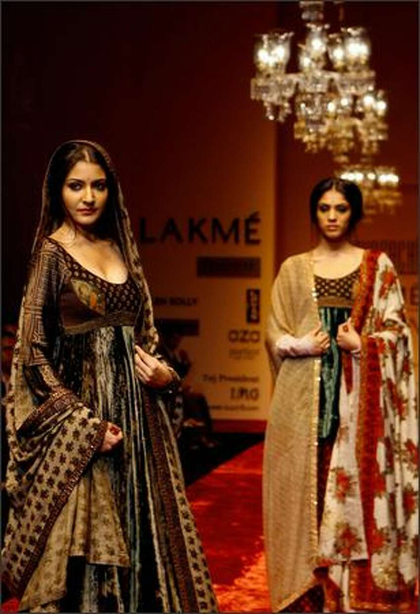 Models display creations by Indian designer Sabyasachi during the Lakme Fashion Week at the National Centre for Performing Arts (NCPA) in Mumbai, 14 October 2007. Fifty-four designers from across India and Pakistan will be displaying their collections during the five-day event in the western Indian city.