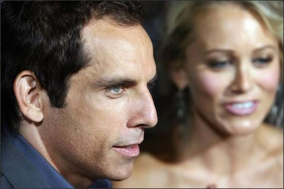 """Actor Ben Stiller arrives with his wife, actress Christine Taylor for the premiere of """"The Heartbreak Kid"""" 27 September 2007 in Los Angeles. The story centers on a man (Stiller) who is convinced that he has finally met the right girl and marries too quickly. While on his honeymoon and in the process of discovering that his new bride is a nightmare, he meets the girl of his dreams."""