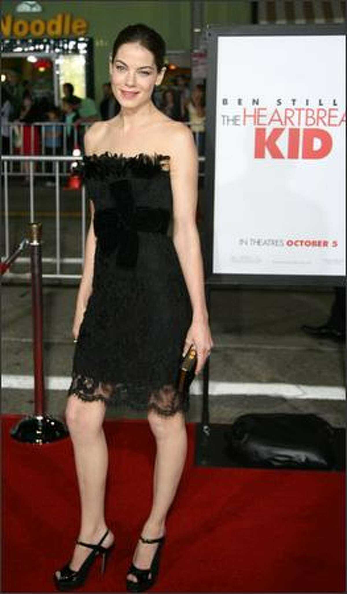 """Actress Michelle Monaghan arrives for the premiere of """"The Heartbreak Kid"""" 27 September 2007 in Los Angeles. The story centers on a man (Ben Stiller) who is convinced that he has finally met the right girl and marries too quickly. While on his honeymoon and in the process of discovering that his new bride is a nightmare, he meets the girl of his dreams."""